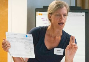 Table captain, Marlies Wierenga, talks to her group at the Sedro-Woolley public workshop